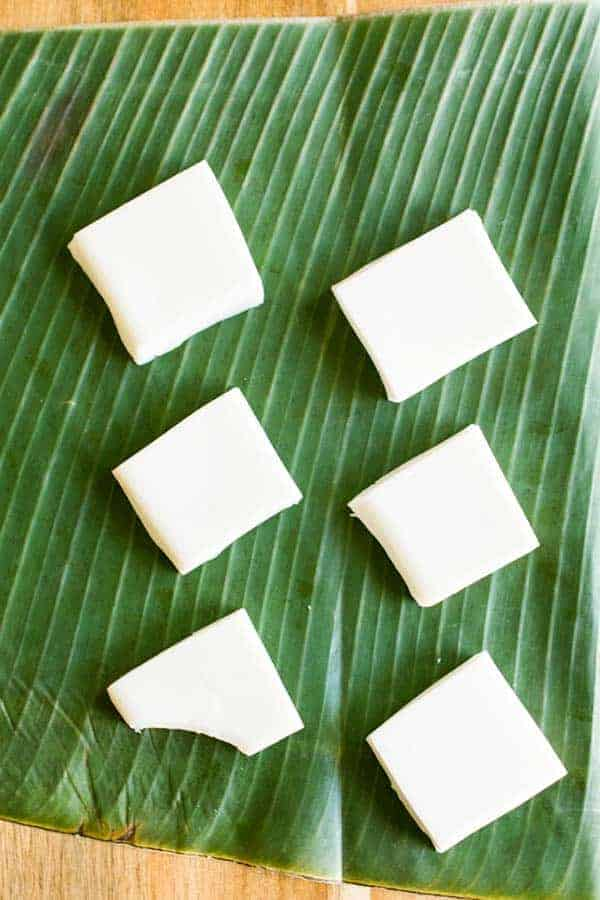 Top down view of haupia squares on a banana leaf